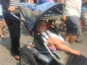 Marched in the parade (read ran) for the first few blocks, then dove into the stroller.