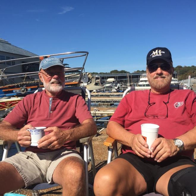 Captains Jim and Ron catching up with coffee on the dock.