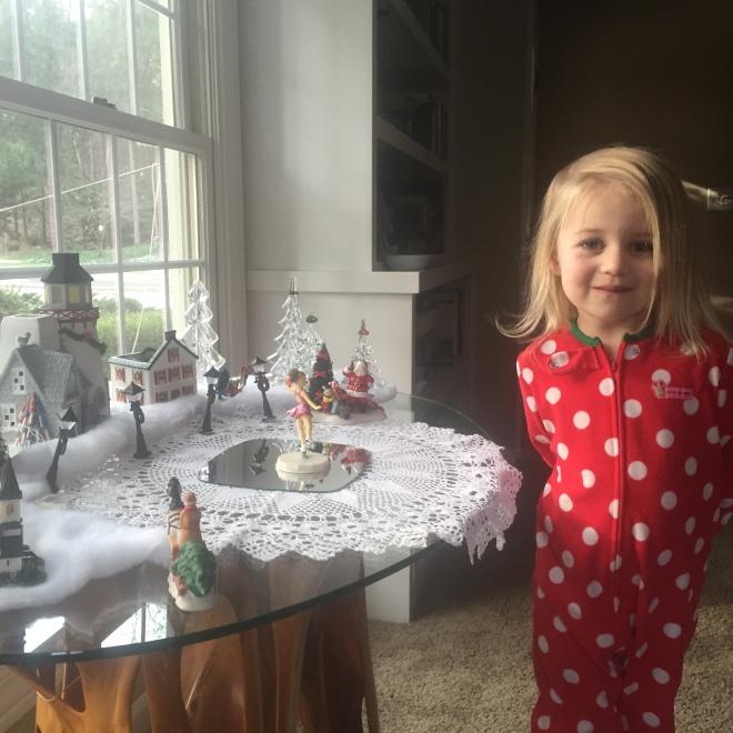 Leonie helping Grandma decorate.